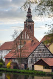 Old houses and church tower in Lidzbark Warminski Stock Photography