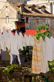 Old houses with clotheslines of laundry drying Stock Photos