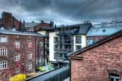 Old houses cloudy sky Stock Photos