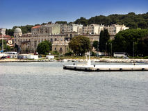 Old houses and coastline in Pula from sea view Stock Photo