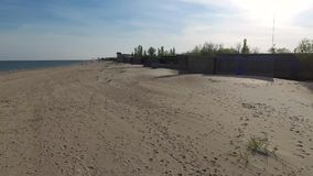Old houses on deserted beach in Odessa bay stock video footage