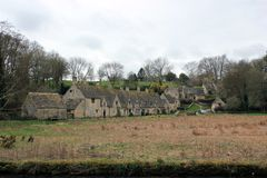 Old houses in english countryside landscape Stock Photography