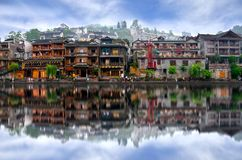 Old houses in Fenghuang county in Hunan, China. HUNAN, CHINA - JUNE 16, 2014 : Old houses in Fenghuang county in Hunan, China. The ancient town of Fenghuang was royalty free stock photos