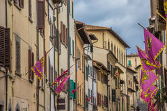 Old houses and flags in the center of Arezzo Stock Photography