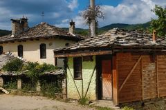 Old houses in the historical cultural reserve village of Dolen, Bulgaria. Royalty Free Stock Photography