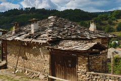 Old houses in the historical cultural reserve village of Dolen, Bulgaria. Stock Images