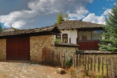 Old houses in the historical cultural reserve village of Dolen, Bulgaria. Royalty Free Stock Photo