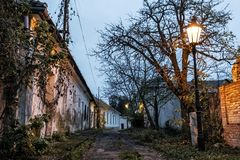 Old houses and lights, evening street scene. Old houses and lights. Evening street scene, Nitra, Slovak republic royalty free stock images