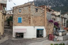 Small shop in old house made of stones. Oliena village, Nuoro Province, Sardinia, Italy royalty free stock photos