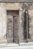 Old wooden door. House made of stones, wood, in Oliena, Nuoro, Sardinia, Italy stock images
