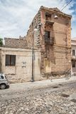 Old houses made of stones, wood, in Oliena village, Nuoro Province, island Sardinia, Italy royalty free stock images