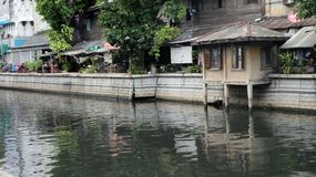 Old houses on Mahanak Canal bank Royalty Free Stock Images