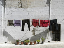 Old houses of Matera, Italy, with clothes hanging Royalty Free Stock Photo