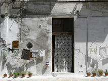 Old houses of Matera, Italy, with clothes hanging. Old houses of Matera (Italy) with clothes hanging Stock Photo