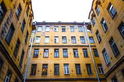 Old houses and narrow courtyards closed city of St. Petersburg, peeling walls and windows of houses Royalty Free Stock Photography