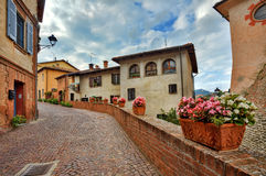 Old houses and narrow street. Barolo, Italy. Stock Images