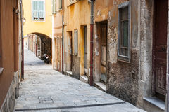 Old houses on narrow street in Villefranche-sur-Mer Royalty Free Stock Photo