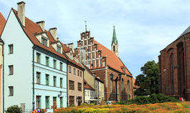 Old houses near St. Peter's Church. Riga, Latvia. Old houses on the street Skārņu at the foot of St. Peter's Church. Riga, Latvia Stock Photos