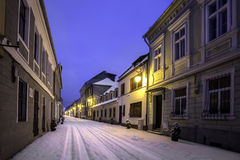 Old houses on one of the main streets of the city of Brasov, Romania. During winter Stock Photo