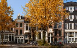 Old houses in Amsterdam. Old houses over canal in Amsterdam at fall, Netherlands royalty free stock images