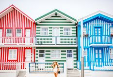 Woman on the colorful buildings background royalty free stock image