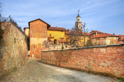 Old houses and paved street in Saluzzo, Italy. Stock Photo
