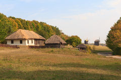 Old houses of the peasants and mill. Pirogovo, Ukraine Royalty Free Stock Images