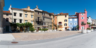 Old Houses in Piran. Panoramic view of some old houses on a small square in the picturesque town of Piran in Slovenia stock photo