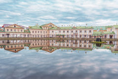 Old houses by the pond. Royalty Free Stock Photos