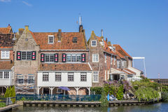 Old houses at the quay in Enkhuizen Stock Photos