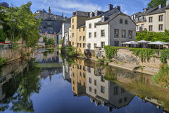 Old houses reflecting Alzette river royalty free stock image