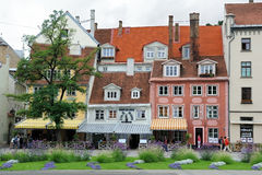 Old houses in Riga. Amatu street in Old Riga with colored old buildings, where restaurantand cafe are located Stock Images