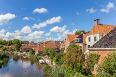 Old houses and river in the village of Winsum. Netherlands Stock Photography
