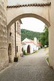 Old houses in town Zlata koruna. Old houses with road viewed thru arch in town Zlata koruna in Czech Republic Stock Photo