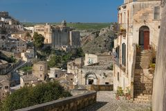 Old town. Matera. Basilicata. Apulia or Puglia. Italy. Old houses in the sassi and Convent of Saint Agostino at the center. Matera. Basilicata. Apulia or Puglia royalty free stock photos