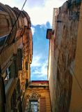 Between old houses. Sky between the old houses royalty free stock image