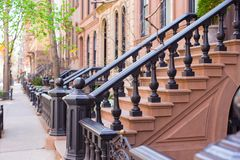 Old houses with stairs in the historic district of. Old houses with stairs in historic district of West Village Stock Photos