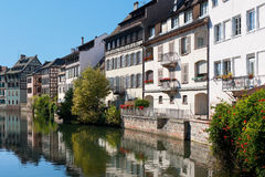 Old houses of Strasbourg. Beautiful old houses of Strasbourg and their reflection in the water. GPS information is in the file stock images
