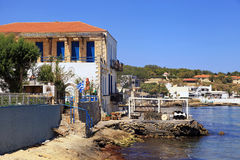Old houses and tavern on sea coast near Rethymno, Crete, Greece Stock Photography
