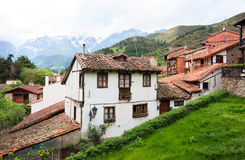 Old houses with tiled roofs in the town of Potes. Stock Photo