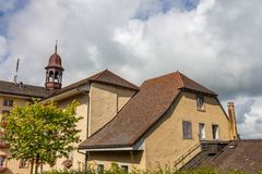 Old houses with tiled roofs and turrets against a cloudy sky in Bern, Switzerland.  royalty free stock image