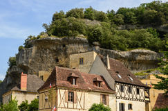 Old houses and troglodyte dwelling in les Eyzies Royalty Free Stock Photo