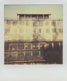 Old houses under renovation in Warsaw, Poland. This is real polaroid high quality scan. Old houses under renovation Royalty Free Stock Photos