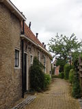 Old houses in the village marsum holland. Looking through the alley with beautiful old houses Royalty Free Stock Photos