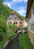 Old houses on a village stream Stock Photo