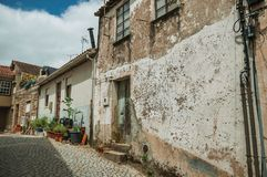 Free Old Houses With Worn Plaster On Deserted Alley Stock Photo - 146755230