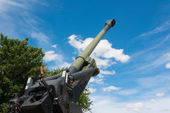 Old Howitzer gun barrel aimed skyward. Howitzer gun barrel pointing skyward in threat Stock Images