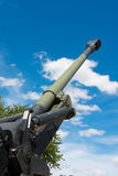 Old Howitzer gun barrel aimed skyward. Howitzer gun barrel pointing skyward in threat Stock Photo