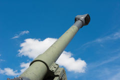 Old Howitzer gun barrel aimed skyward. Howitzer gun barrel pointing skyward in threat Stock Image