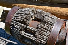 Old hub of a wood wagon wheel. Closeup of an old wooden hub of a wagon wheel with had wood spokes also Royalty Free Stock Photography
